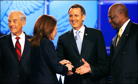 Rep. Michelle Bachmann and former Gov. Tim Pawlenty shake hands before Monday's deabte.