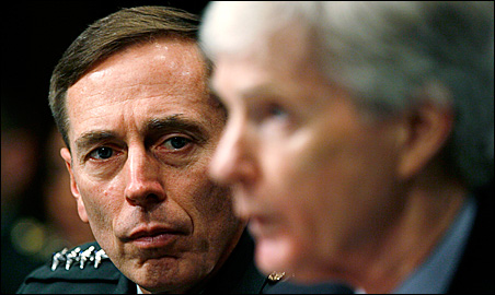 Gen. David Petraeus, left, listens as Ambassador Ryan Crocker testifies before the Senate Armed Services Committee Tuesday.