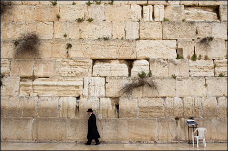 An ultra-Orthodox Jewish man walks in front of the Western Wall, Judaism's holiest prayer site, in Jerusalem's Old City.