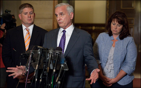 Gov. Mark Dayton speaking to reporters Thursday night.