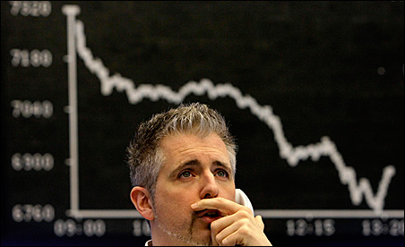 A trader on the phone in front of the DAX board
