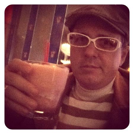 Max drinks a pomegranate margarita at Rosa Mexicano