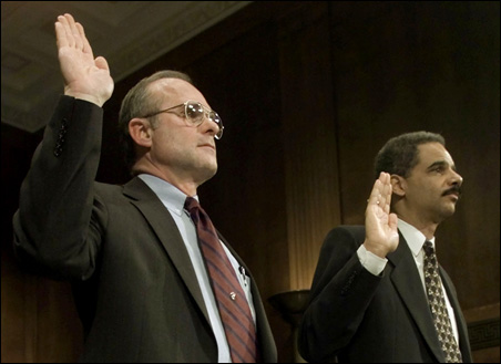 Roger Adams (left) and Eric Holder, are sworn in before giving their testimony before the Senate Judiciary Committee in 2001.