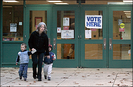 Kathleen Burke leaves Cunningham Park Elementary School with her twin sons after voting in Vienna, Virginia, Tuesday.