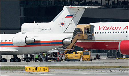 Russian and U.S. aircraft stand on the tarmac in front of the Skylink terminal building, during an exchange of spies, at Vienna Airport on Friday.