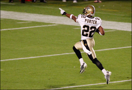 New Orleans Saints cornerback Tracy Porter runs back an interception for a touchdown against the Indianapolis Colts in the fourth quarter.