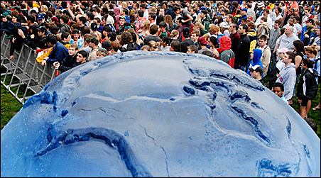 Concertgoers are seen behind a painted globe at Sunday's concert for Earth Day in Washington.