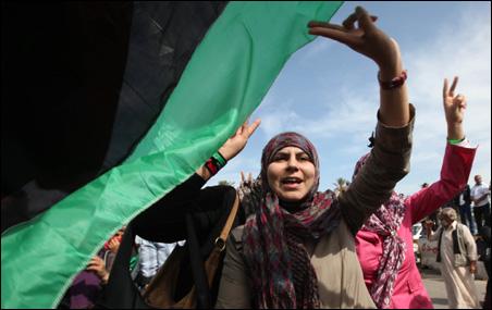 Libyans celebrating the death of Muammar Gaddafi in Martyrs Square on Thursday.
