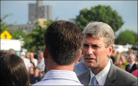 Minneapolis Mayor R.T. Rybak speaks with event attendees after the Remembrance Garden opening.