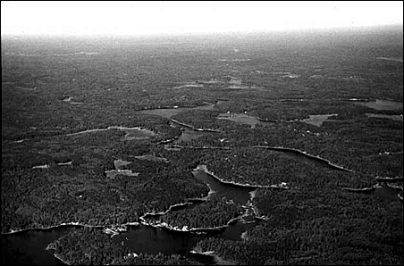 Aerial view of Basswood Falls and river looking west circa 1980.