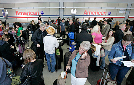 Passengers at Chicago's O'Hare International Airport line up after American Airlines canceled nearly 45 percent of its daily schedule Wednesday.