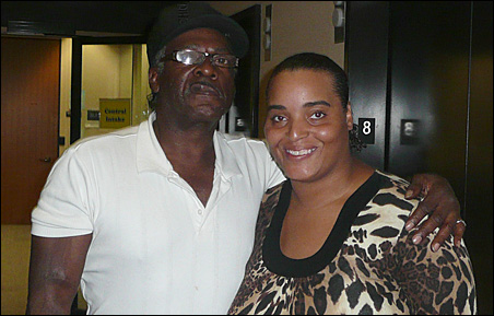Regina Traylor's fiance, Robert Collins, was on hand Tuesday to offer support as she wrapped up a nearly two-year-old case by pleading guilty to voting illegally.