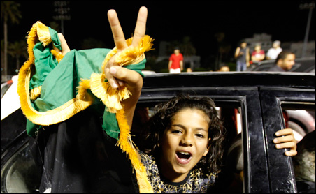A Libyan girl celebrates in Green Square in Tripoli on Tuesday.