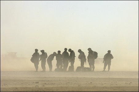 Troops wait for a helicopter in the desert in Tikrit, Iraq.
