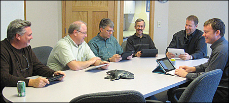 Lancet Software owner Tom Niccum, second from left, recently equipped his 40-person staff with iPads.