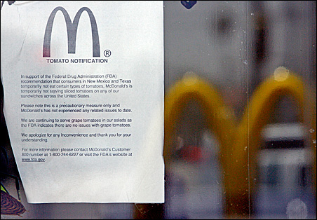 McDonald's is pulling tomatoes from its menu and informing customers with notices such as this one at a store in Los Angeles.