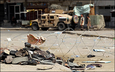 Sandals belonging to victims are seen at the site of a bomb attack in Baghdad on Tuesday.
