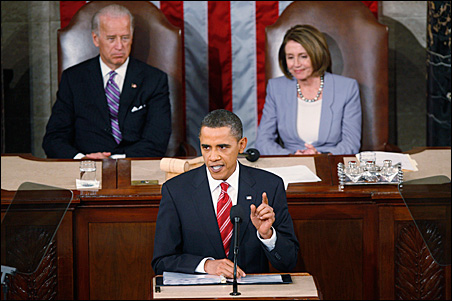 President Obama delivers his State of the Union address, as Vice President Joe Biden and House Speaker Nancy Pelosi listen.