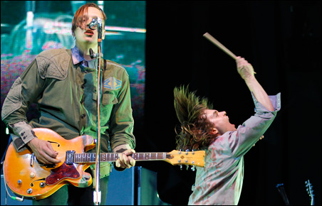 Members of Arcade Fire performing at the Coachella Valley Music & Arts Festival in April.