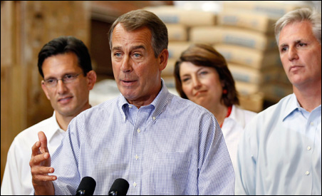 John Boehner, second from left, is shown speaking in Virginia on Sept. 23 with, left to right, House Republican Whip Eric Cantor, House Republican Conference Vice Chair Cathy McMorris Rodgers, and House Republican Chief Deputy Whip Kevin McCarthy.