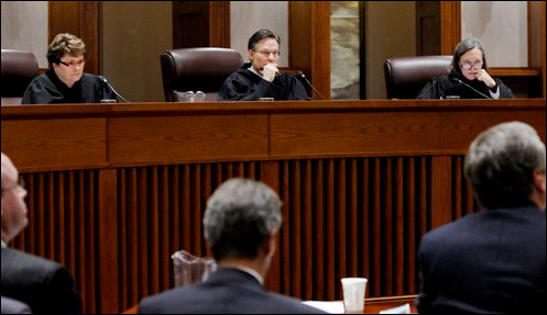 From the left, Judges Elizabeth Hayden, Kurt Marben and Denise Reilly today issued a highly anticipated ruling limiting the universe of rejected absentee ballots to be reconsidered.
