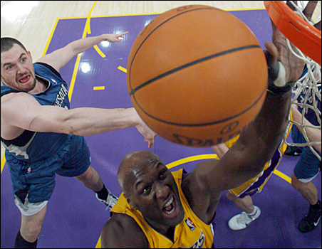 The Timberwolves' Kevin Love, left, and the Lakers' Lamar Odom shown fighting for a rebound during their Nov. 9 game in Los Angeles.