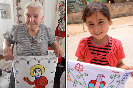 Nasra Simmes Hindi holding up one of her painted clothes (with others in the background). Unnamed Syrian girl holding one of her embroideries.