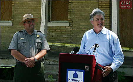 Standing in front of the 1891 Guard House, Hennepin County Commissioner Peter McLaughlin (right) and Paul Labovitz of the National Park Service discuss plans to restore and repurpose Fort Snelling's Upper Post.