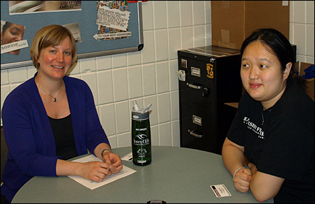 Sarah Hover, Director of Career and Employment Services at Inver Hills Community College, left, discussed career prospects with student Melissa Bietz.
