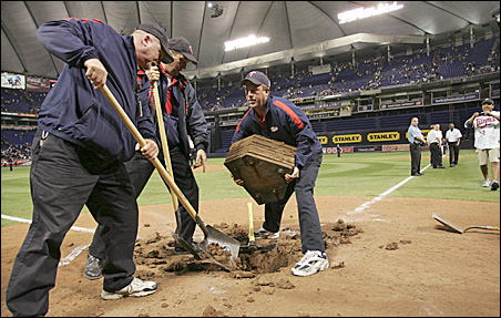 The grounds crew digs up home plate at the conclusion of the final Twins game in the Metrodome, Sunday, Oct. 11, 2009.
