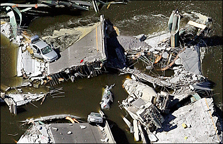 Vehicles lie amid the rubble of the I-35W bridge which spans the Mississippi River. Despite suffering and recovering from harrowing injuries, survivors are still dealing with psychological wounds.