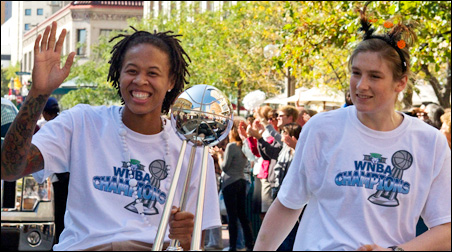 Seimone Augustus and guard Lindsay Whalen in Tuesday's parade.