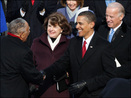 President Obama shakes hands with the Rev. Dr. Joseph Lowery as Vice President Biden and U.S. Sen. Dianne Feinstein watch.