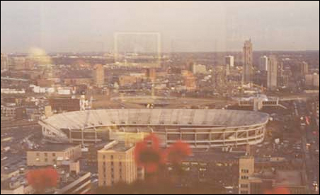 A 1980 aerial view of the construction of the Metrodome looking down Sixth Street South toward the Cedar Riverside area.