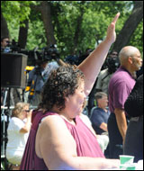 An attendee raises her hand to ask a question.