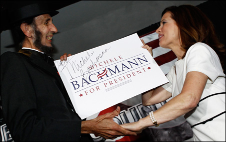 Rep. Michele Bachmann greeting a man dressed as Abraham Lincoln at the Republicans of Black Hawk County Dinner in Waterloo on Sunday.