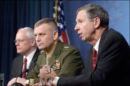 NASA administrator Michael Griffin (right), comments last week on the plan to destroy a rogue spy satellite. Others at the announcement are Marine Gen. James E. Cartwright (center), and James F. Jeffrey, deputy national security adviser.