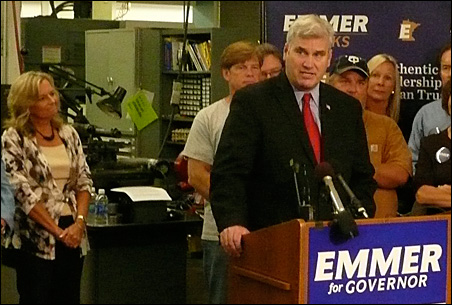 Permac CEO Darlene Miller, left, listens as Tom Emmer announces his job creation plan during a Monday press conference.