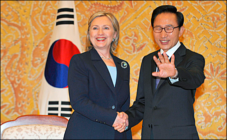 South Korean President Lee Myung-bak, right, shakes hands with Secretary of State Hillary Clinton during their meeting at the Presidential Blue House in Seoul on Wednesday.