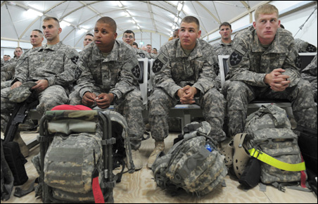 U.S. soldiers at Camp Virginia in Kuwait listen to instructions as they wait for their flight back to the U.S.