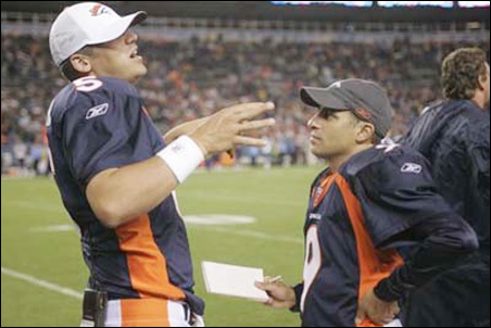 Fatsis, on the sidelines with Preston Parsons, during a 2006 Broncos home game against the Tennessee Titans.