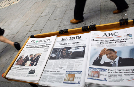 People walk past Spanish newspapers with pictures of President-elect Barack Obama on the front pages at a news stand in Madrid.