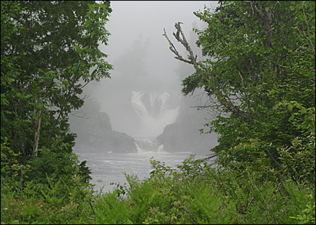 Magpie High Falls near Wawa, Ontario, is barely visible through the heavy fog near Lake Superior.