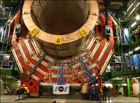 A single piece of the Large Hadron Collider is lowered into place by sturdy cables.