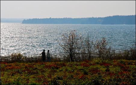 Visitors take a walk near the shore of Lake Superior in Washburn.