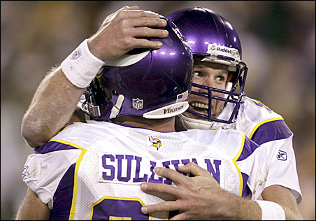Minnesota Vikings quarterback Brett Favre hugs his center John Sullivan after giving the Green Bay Packers the ball on downs with 27 seconds left in the game.