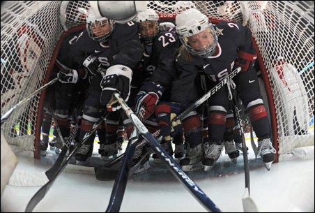 The U.S. team huddles around the net during a pregame ritual before their semifinals game on Monday.