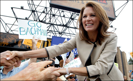 Rep. Michele Bachmann greets her supporters during a rally in Costa Mesa, Calif., on Friday.