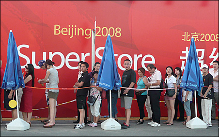 Visitors stand in line to buy souvenirs at the Olympic Green Super Store.