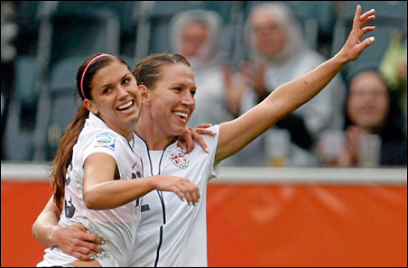 Alex Morgan, left, celebrates with teammate Lauren Cheney during the Women's World Cup semi-final soccer match against France on Wednesday.